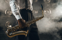Black Jazz Musician With Saxophone On The Stage