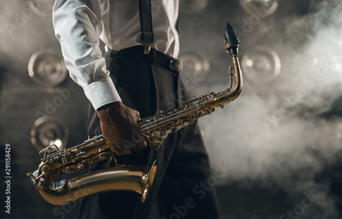 Black jazz musician with saxophone on the stage Canvas Print