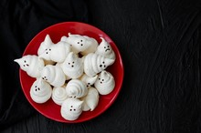 Ghosts Halloween Meringues With Chocolate Sauce On The Plate On A Black Background.  Food Idea For Halloween Party.