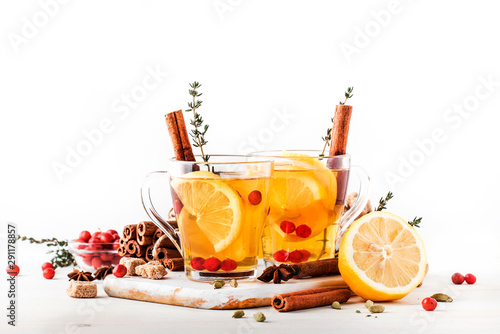 Cadres-photo bureau The Winter or autumn healing hot tea with lemon, cranberries, thyme and spices, white background, copy space, selective focus