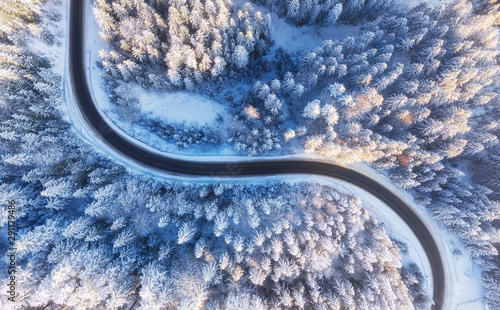 fototapeta na ścianę Aerial view on road and forest at the winter time. Natural winter landscape from drone. Winter - image