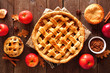 canvas print picture - Homemade autumn apple pies, overhead view table scene with a rustic wood background