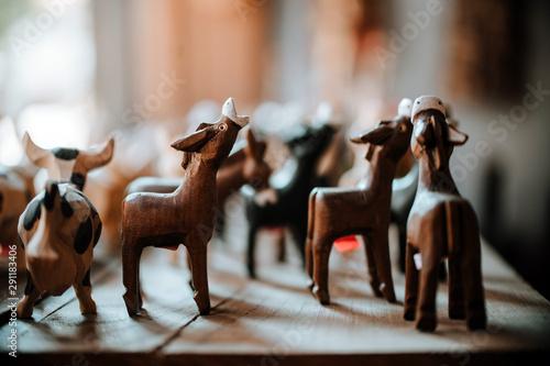 Handmade wooden animal souvenirs in traditional workshop Fotobehang