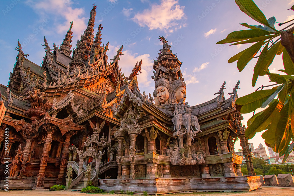 Fototapety, obrazy: Thailand. Fragment of the Temple of truth in Pattaya. A huge wooden temple with carved decorations. Buddhist temple. Religious building in Pattaya. Tourist attraction of Thailand.