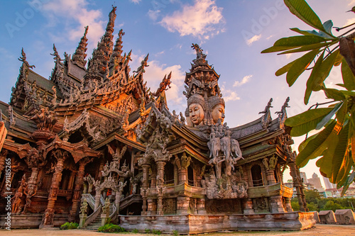 Fotobehang Bedehuis Thailand. Fragment of the Temple of truth in Pattaya. A huge wooden temple with carved decorations. Buddhist temple. Religious building in Pattaya. Tourist attraction of Thailand.