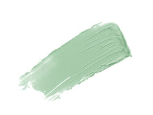 Color Corrector Stroke Isolated On White Background. Mint Freen Correcting Cream Concealer Smudge Smear Swatch Sample. Makeup Base Foundation Creamy Texture
