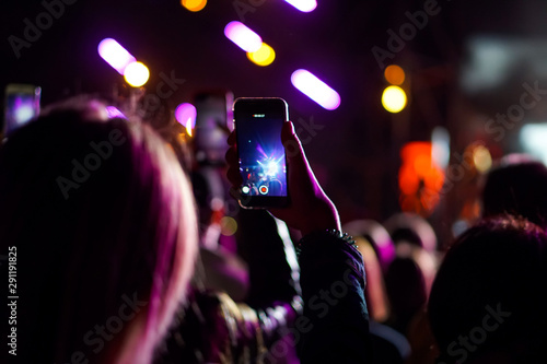 Close up of photographing with smartphone during a concert - 291191825
