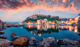 Breathtaking evening cityscape of Vrbnik town. Dramatic summer seascape of Adriatic sea, Krk island, Croatia, Europe. Beautiful world of Mediterranean countries. Traveling concept background.