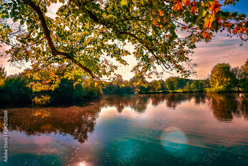 Autum Fall sunset colours warm outside lake water still smooth red blue dreaming Canvas-taulu
