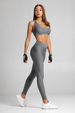 Sexy Fitness Woman. Beautiful Athletic Girl On The Gray Background