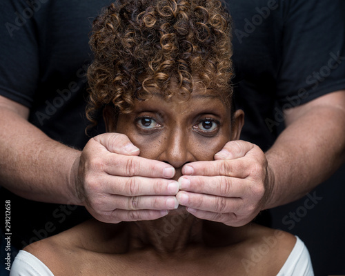 Black woman being silenced by white man in racism Canvas Print