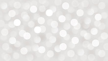 Vector Defocused Bokeh Lights. Silver Glitter Christmas Abstract Background.