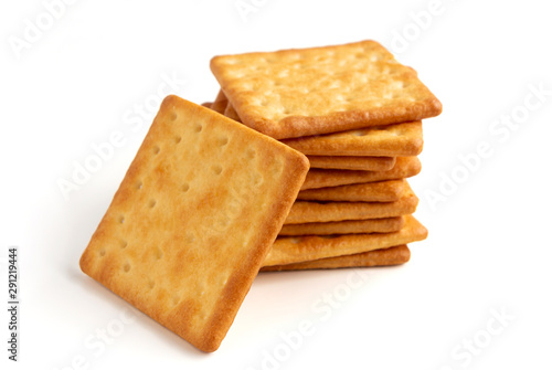 Vászonkép Crushed dry cracker cookies isolated on white background