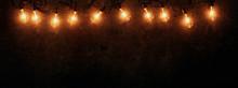 Row Of Lit String Light Bulbs ...