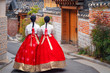 Leinwanddruck Bild - Korean lady in Hanbok or Korea dress and walk in an ancient town in seoul