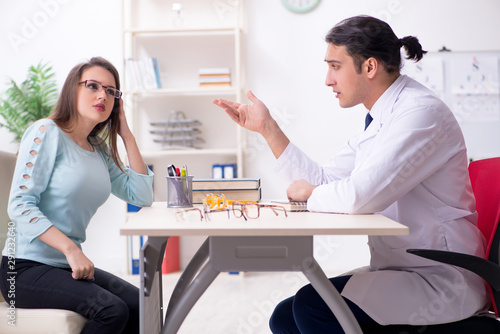 Fototapety, obrazy: Young woman visiting male doctor oculist