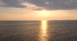 View from ship board while sailing on sea waves and morning sunrise in sky. Slow motion of the sea surface with small waves against the backdrop of the sunrise of the sun. Solar path on the water. Gol
