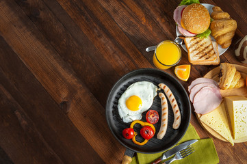 Fried sausage with eggs and vegetables