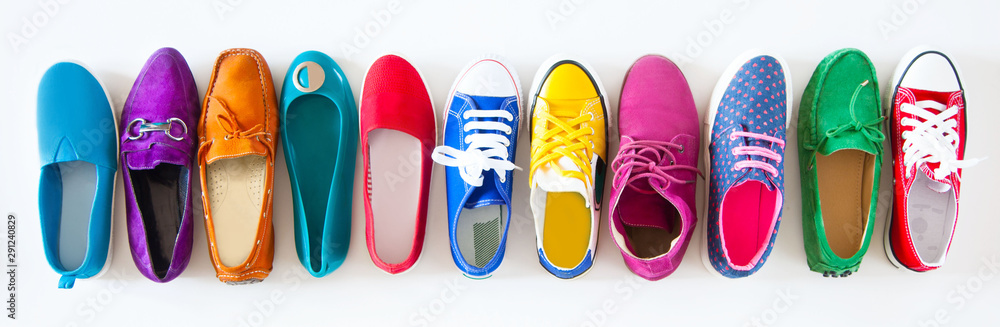 Fototapety, obrazy: A lot of colored youth women's shoes without heels. Sneakers, slippers, ballet shoes. White background.