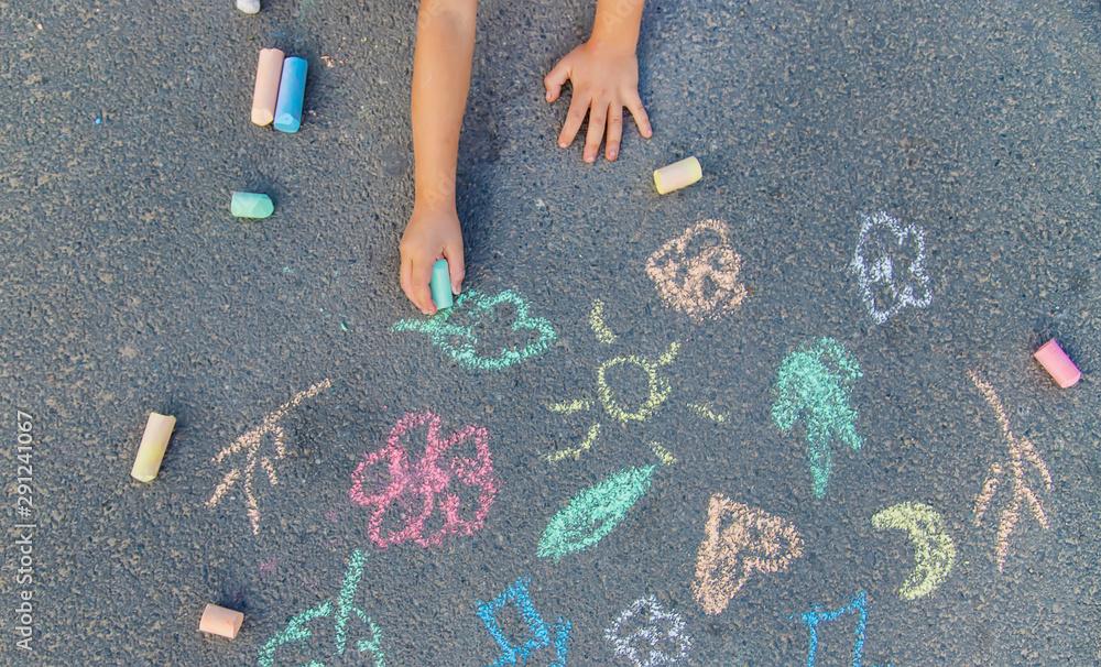Fototapeta Children's drawings on the asphalt with chalk. Selective focus.