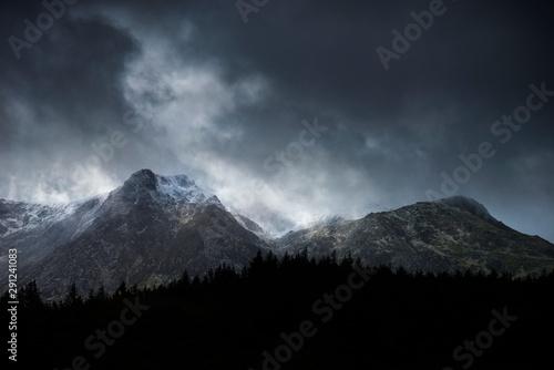 Fototapeta  Stunning moody dramatic Winter landscape image of snowcapped Y Garn mountain in