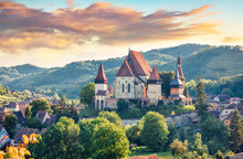 Splendid Summer View Of Fortified Church Of Biertan, UNESCO World Heritage Sites Since 1993. Colorful Morning Cityscape Of Biertan Town, Transylvania, Romania, Europe. Traveling Concept Background.