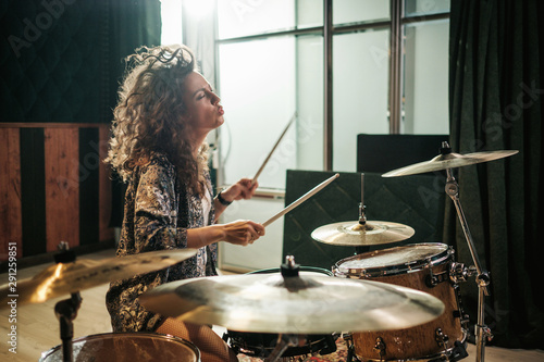 Canvastavla Woman playing drums during music band rehearsal