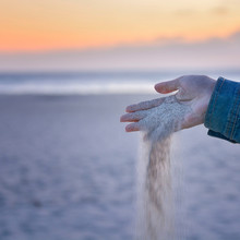 Sand Falling From The Hand Like An Hourglass. Tempus Fugit.