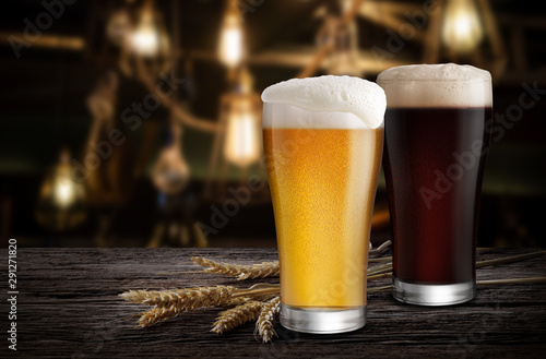Glasses of Light Beer and Dark Beer with wheat on the bar counter in the restaur Wallpaper Mural