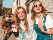 canvas print picture - Portrait of three young beautiful smiling hipster girls in trendy summer clothes. Sexy carefree women posing near wall in the street.Positive models having fun in sunglasses