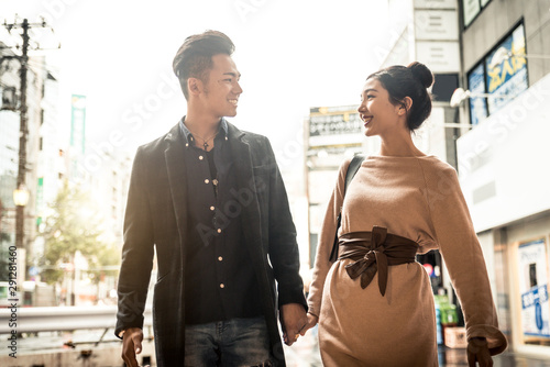 Fotografie, Tablou  Happy japanese couple dating outdoors in Tokyo
