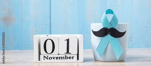 Photo Blue coffee cup, blue ribbon, Black mustache and 1 November Calendar
