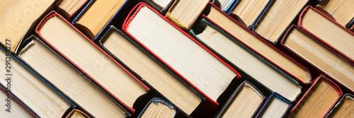 Fotografía Stack of books background. many books piles.