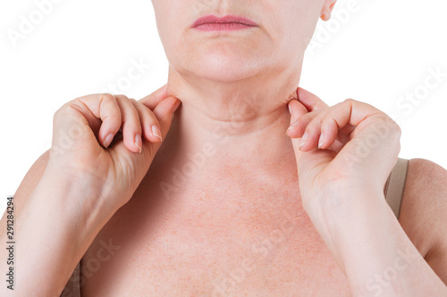 Vászonkép  Flabby skin on the neck of an elderly woman isolated on white background
