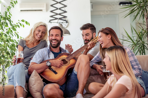 Group of friends have fun with guitar - 291288080
