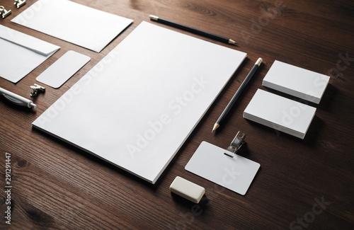 Fototapeta Photo of blank corporate stationery set on wood table background. Template for branding design. obraz