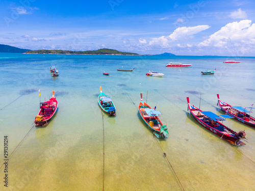 Recess Fitting Water Motor sports Wooden travel boat on sea beach turquoise water