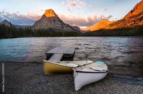 A sunrise across Two Medicine Lake in Glacier National Park, Montana, USA