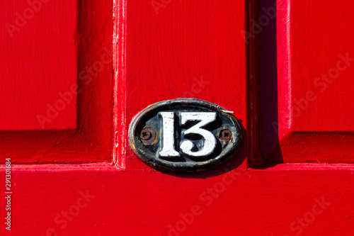 Valokuvatapetti Number 13 on a bright red wooden front door