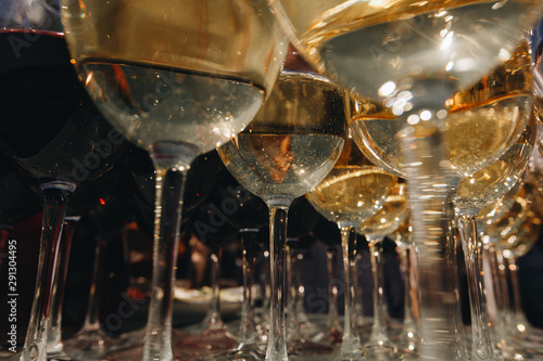 Glasses with white wine. Closeup