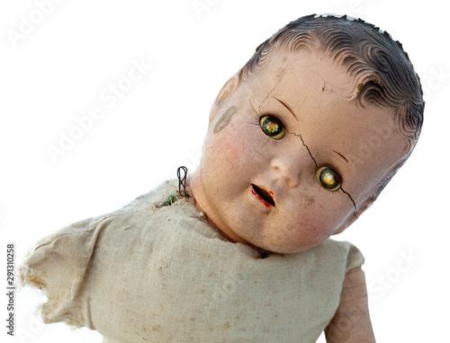Obraz na plátne Creepy old doll head with glowing evil eyes.