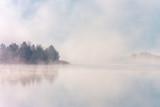 Beautiful foggy morning. Misty lake coast. Fog over autumn lake water. - 291311462