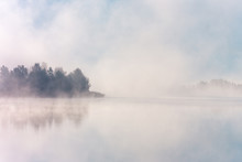 Beautiful Foggy Morning. Misty Lake Coast. Fog Over Autumn Lake Water.