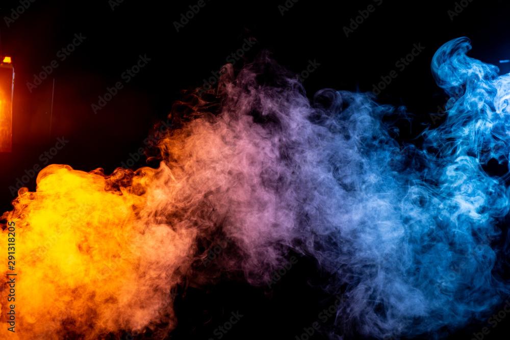 Fototapeta colored smoke on black background