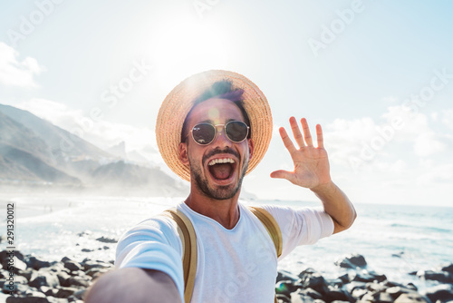 Obraz Young male hipster doing selfie in Tenerife, Canary Island - fototapety do salonu