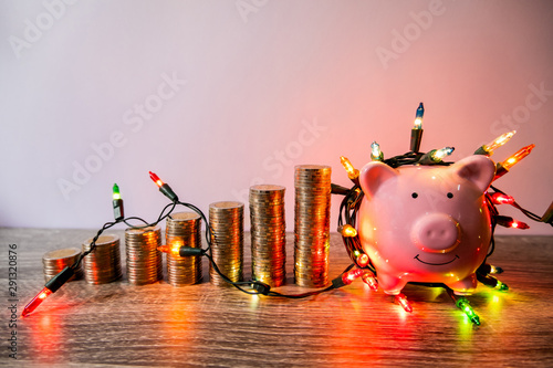 Fototapeta Pink piggy bank with party light, organize a party for the event where successful in saving money for use in various festivals obraz