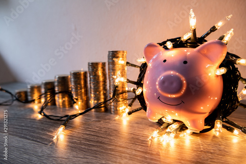 Fotografia  Pink piggy bank with party light, organize a party for the event where successfu