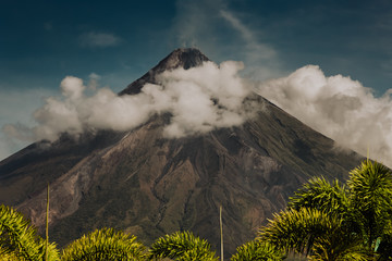 Fototapeta Industrialny Asian Mayon Volcano on Luzon Island Philippines. Tropical Trees Palms, High Mountain Peak and Clouds Sky. Panoramic Photo on Wonderful Famous National Tourist Landscape View from Climb