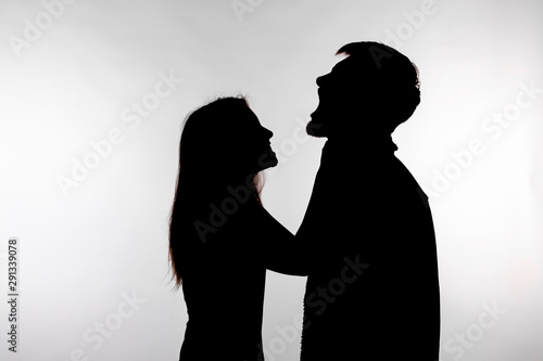 Photo Domestic violence and abuse concept - Silhouette of a woman asphyxiating a man