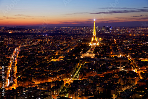 Poster de jardin Paris Eiffel Tower, Les Invalides and business district of Defense at blue hour, as seen from Montparnasse Tower, Paris, France